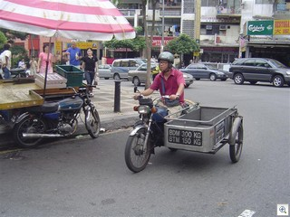 Malaysian ice man on motorcycle