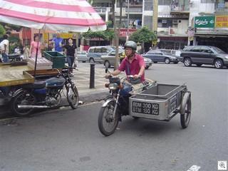 Malaysian ice man on motorcycle